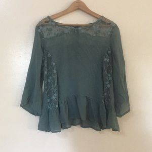 Sheer green blouse with simple floral detailing
